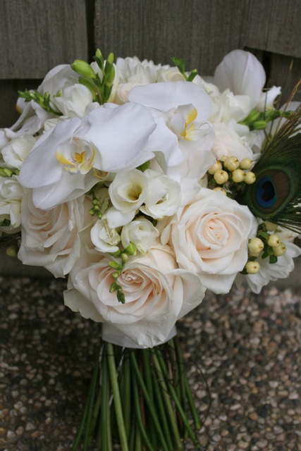 Jennifer's bridal bouquet with roses, freesia, berries, orchids and feathers