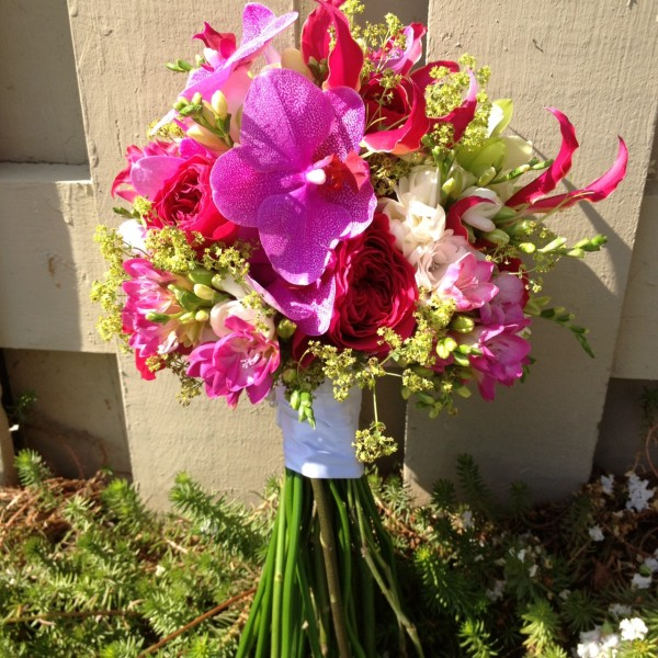 Bridal bouquet with orchids, ladies mantel, freesia and roses