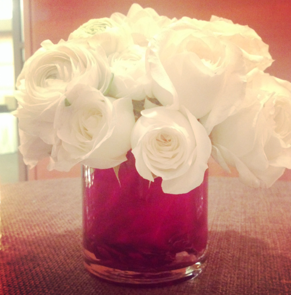 Purple cabbage inside vase with white roses